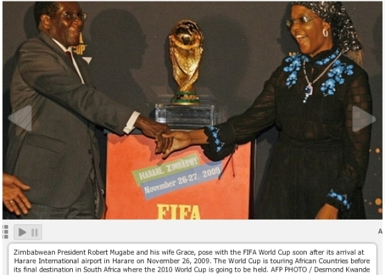 President Mugabe and his wife Grace pose with the FIFA World Cup, November 26 ,2009
