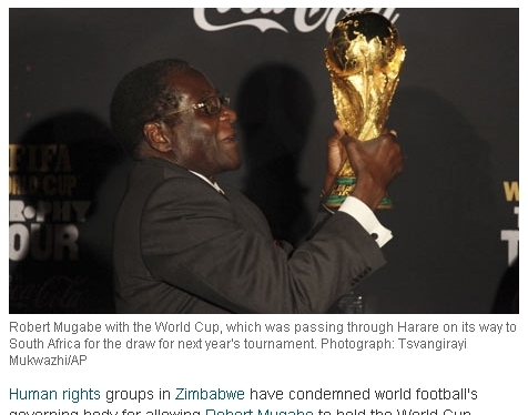 Robert Mugabe with the World Cup, which was passing through Harare on its way to South Africa