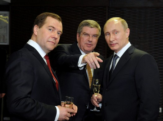 Russia's President Putin, Prime Minister Medvedev and International Olympic Committee (IOC) President Bach of Germany speak before the closing ceremony for the 2014 Sochi Winter Olympics